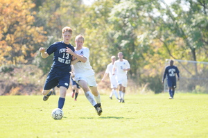 Soccer Junior Michael Blasi fights for the ball against a PSU Mont Alto player in 2011.
