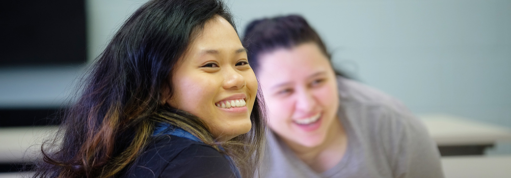 international student smiles in classroom