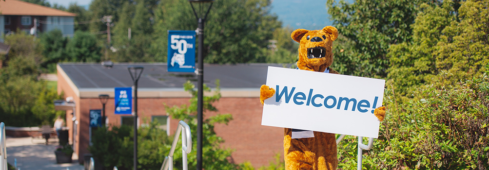 Nittany Lion Mascot with a Welcome sign