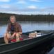 Dr. Dale Holen in boat at state park