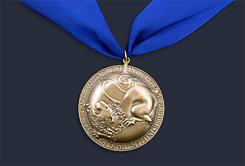 gold honors medal hanging from a blue ribbon
