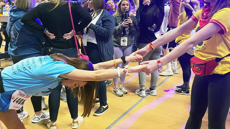 Dancer Lauren gets some help stretching out during THON