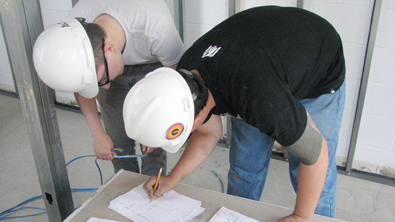 students reviewing wiring plans
