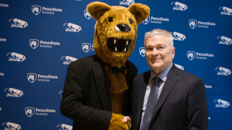 Dr. Eric Barron with the Nittany Lion
