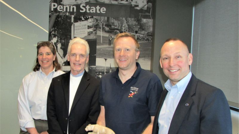 cesari holding Nittany Lion with faculty members