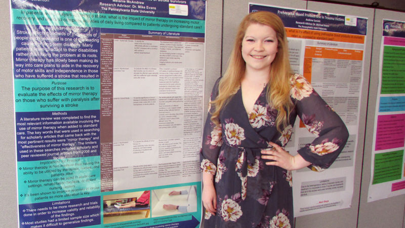 Melanie McAndrew and her poster