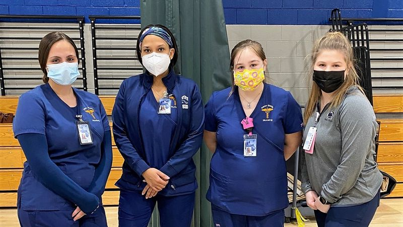 four nursing students pose for a photo at the Throop civic center vaccination clinic