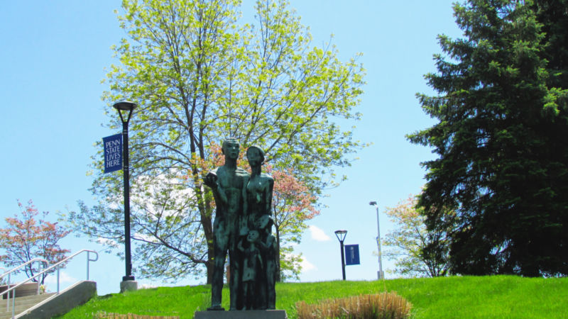"Large outdoor sculpture, ""The University of Family"" at PSWS by artist Oliver LaGrone, has graced a campus hillside for 40 years."