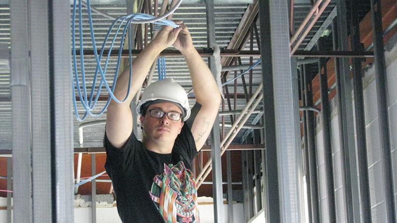 Thomas kraser installing wiring in the Dawson Building