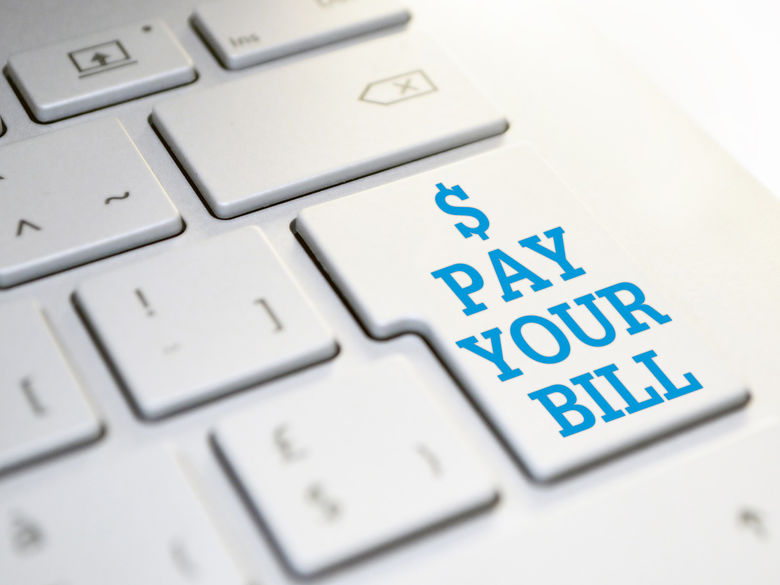 button on computer keyboard reads $ Pay Your Bill