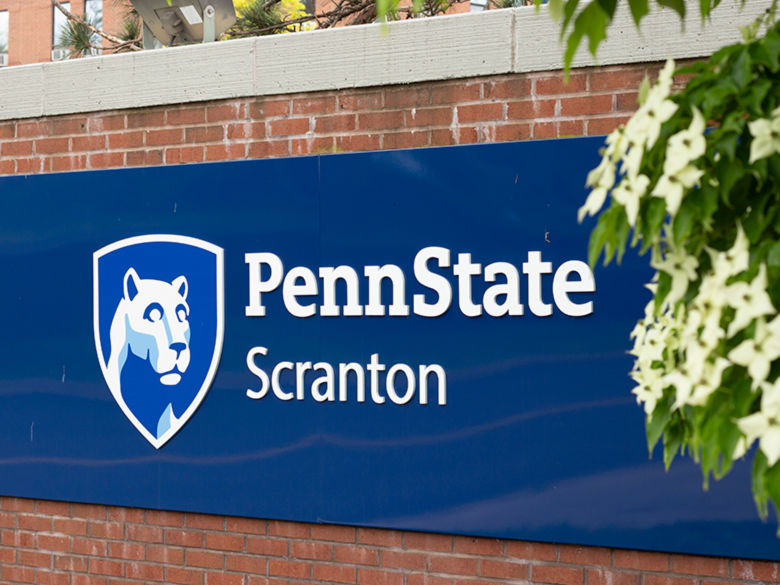 Blue Penn State Scranton sign on brick entrance way.