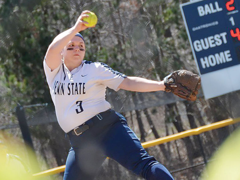 Penn State softball player winds up to pitch the ball