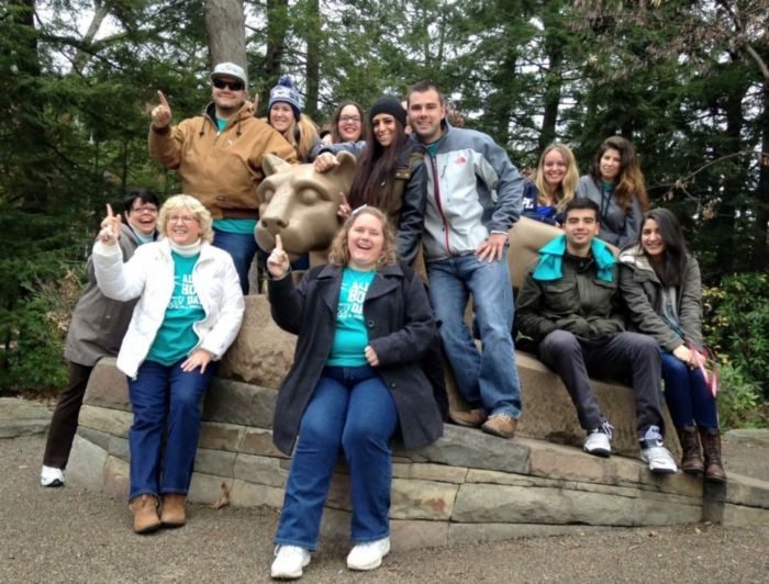 club members at Nittany Lion shrine