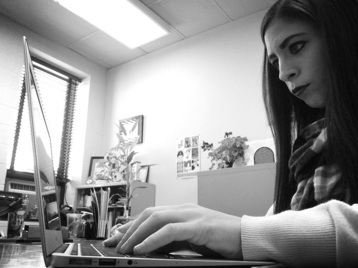 Shawnna on laptop at internship office