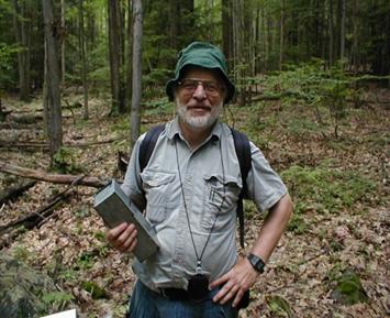 Dr. Byman doing field work