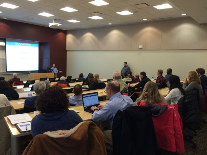 Faculty presenting slides at development event
