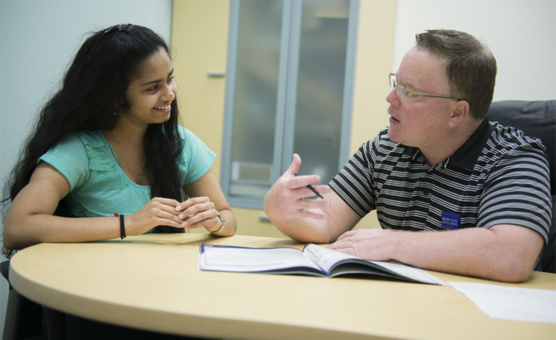 Jon Tobin, career services coordinator, meets with a student to discuss opportunities such as mentoring and internships that she can use to start building career experience while still in college.