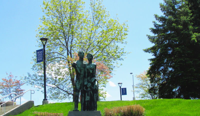 """Large outdoor sculpture, """"The University of Family"""" at PSWS by artist Oliver LaGrone, has graced a campus hillside for 40 years."""