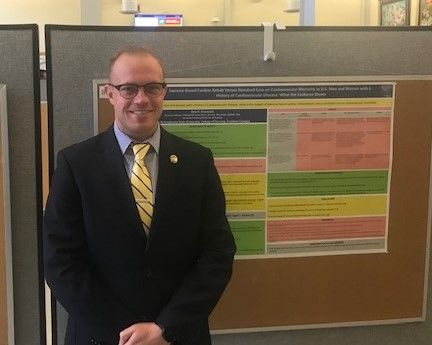 Student Kyle Franceski standing near his poster at the Penn State Eastern Regional Undergraduate Research Symposium at Penn State Hazleton, 2019
