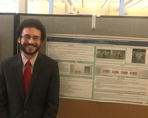 Student Nicholas Kremp standing near his poster at the Penn State Eastern Regional Undergraduate Research Symposium at Penn State Hazleton, 2019