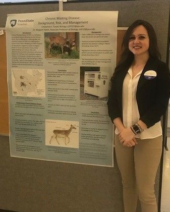 Student Cheyenne Tussel standing near her poster at the Penn State Eastern Regional Undergraduate Research Symposium at Penn State Hazleton, 2019