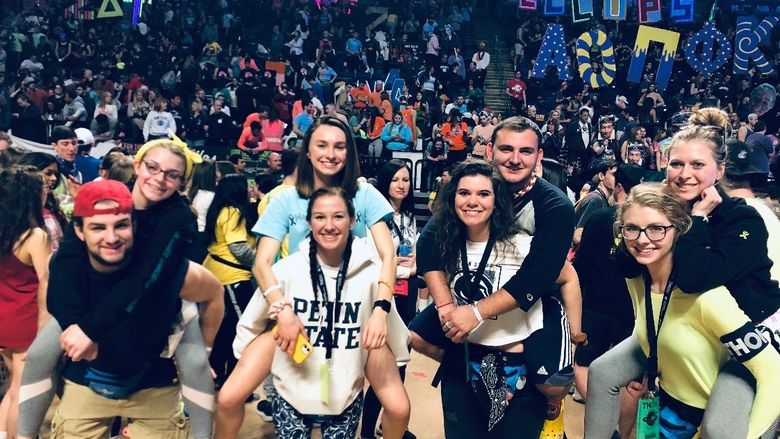 THON dancers get a piggyback ride from the dance floor at end of THON