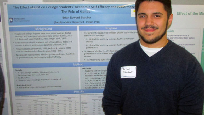 Student researcher Brian Escobar with his project at the Undergraduate Research Fair