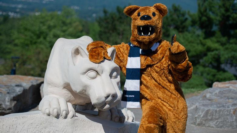 nittany lion mascot posing for photo at scranton lion shrine