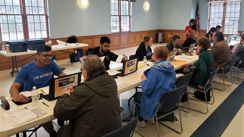 Students helping individuals with tax returns