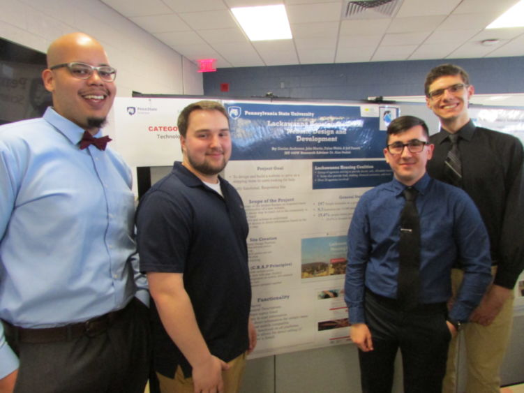 Students showing project at research fair